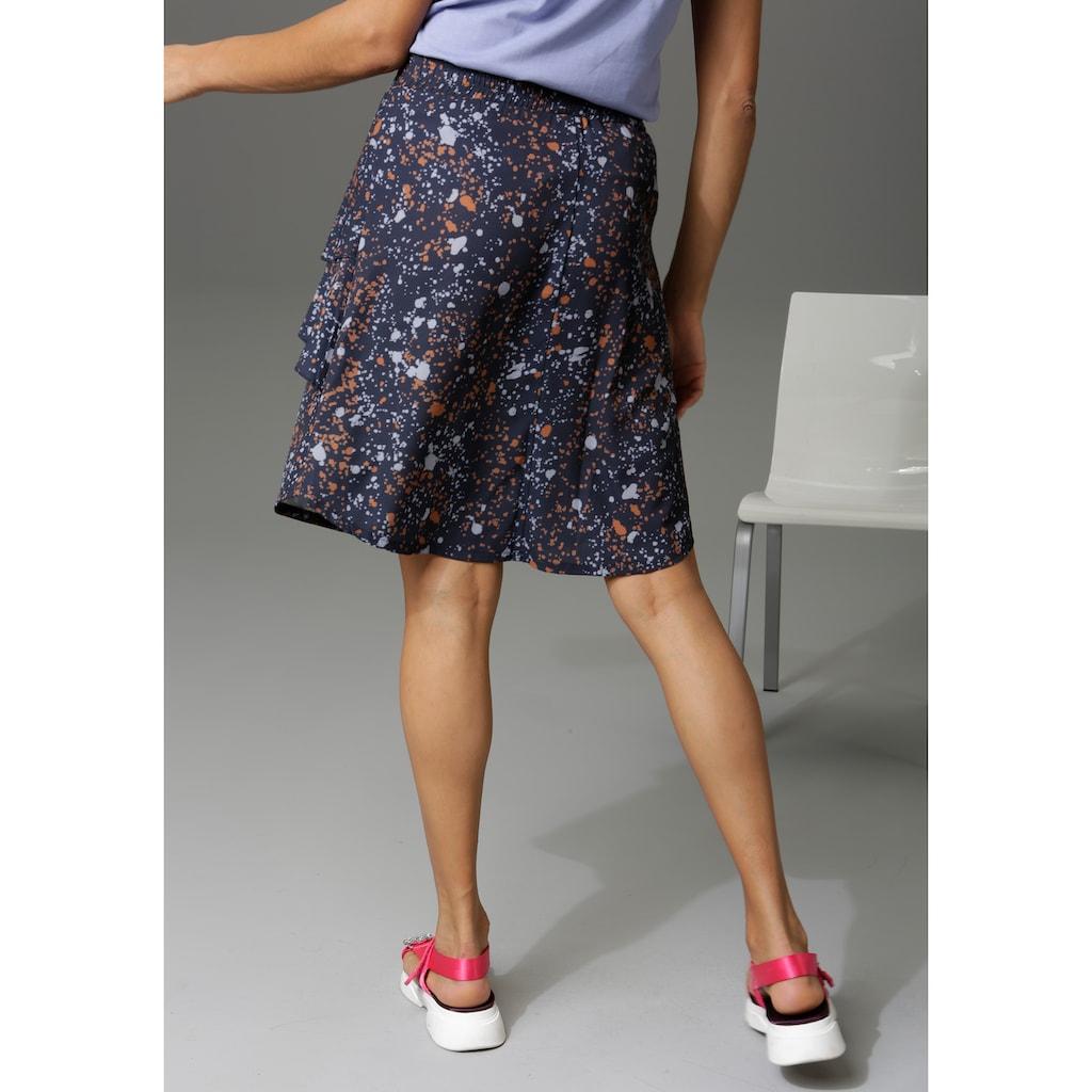 Aniston CASUAL Sommerrock, mit verspielten Volants im Vorderteil - NEUE KOLLEKTION